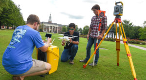 Surveying and Geomatics students at work on the quad at the Troy Campus. The program recently won a national award for quality and excellence.