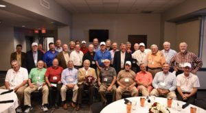 Members of the 1968 Troy State Red Wave national championship football team recently reunited at Veterans Memorial Stadium.