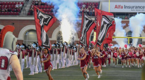Troy University will honor four alumni with Alumni of the Year awards during Saturday's Homecoming football game.