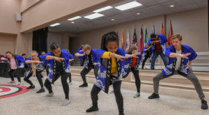 TROY students perform the traditional Japanese Fisherman Dance during Tuesday's International Rotary Luncheon at the Troy Campus.