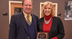 Dr. Chris Shaffer, dean of libraries, presents Dr. Jeneve Brooks with the Book Token Award for her support of the University's libraries.