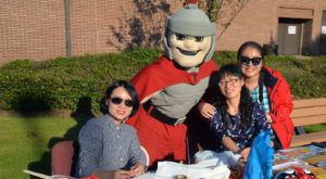 T-Roy visits with scholars at the Confucius Institute table during Tuesday's Homecoming celebration on the Montgomery Campus.