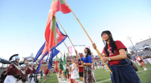 International students at Troy University display flags from their home countries prior to TROY's football game on Oct. 4.