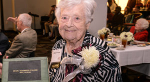 Rillie A. Simmons, a 103-year-old alumna of Troy State Teacher's College, holds her degree at the World War II-era alumni reunion Friday night.