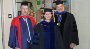 Dr. Allen Dennis, right, strikes a pose with Dr. William Welch and Dr. Scout Blum in the College of Arts and Sciences following a commencement.