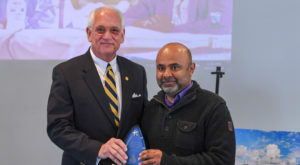 Dr. Jack Hawkins, Jr., Chancellor, presents the 2018 Chancellor's Award of Distinction in Sponsored Programs to Dr. Govind Menon.