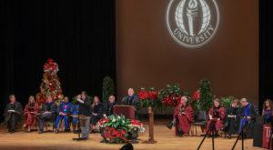 Dr. Earl Ingram speaks to about 130 graduates at Troy University's fall 2018 commencement at the Dothan Campus,