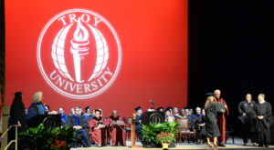 Nearly 120 graduates received diplomas Monday night at Troy University's commencement ceremony at the Montgomery Campus.