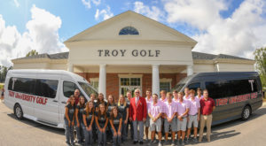 Members of the men and women's golf teams pose with their new sprinter vans, purchased with the help of a group of donors.