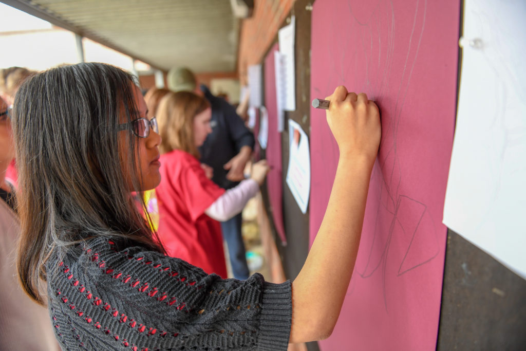 Northview High School student Somuri PukVan participates in progressive drawing during Trojan Art Day at the Troy University Campus on Friday, February 15, 2019.