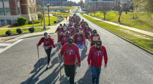 Military veterans Gabriel Sistrunk and Manny Acosta lead the brothers of Alpha Tau Omega up the first hill of Walk Hard 2019. (TROY photo/J. Meredith)