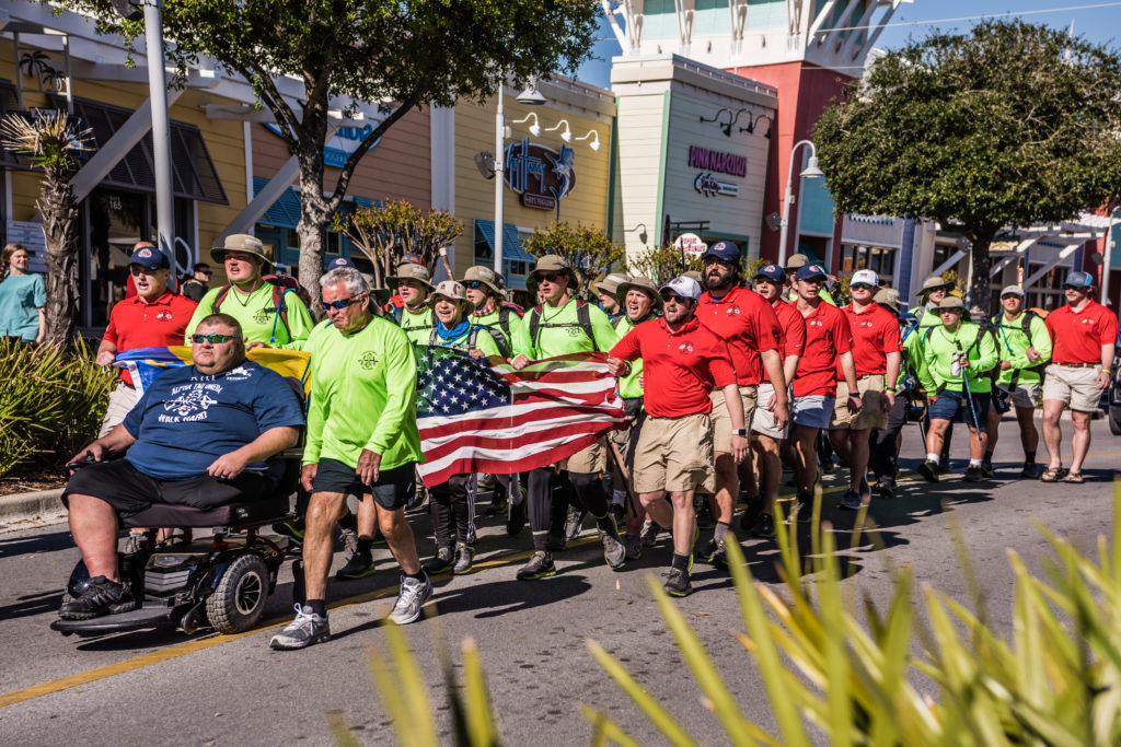 Walk Hard participants and military veterans reach Pier Park in Panama City Beach, Florida, in 2018.