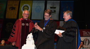 Michael Orlofsky, professor of English, receives the Ingalls Award during last year's Honors Convocation. This year's event is set for April 25.