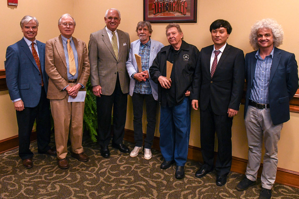 Spooner Oldham and Dan Penn, center, holding the Hall-Waters Prize trophies. From left to right: Walter Givhan, Senior Vice Chancellor for Advancement and External Relations, Greg Swem, Chancellor Dr. Jack Hawkins, Jr., Oldham, Penn, Hao Yin and Dr. Kirk Curnutt.