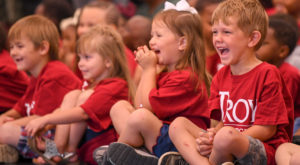 TROY's children's theater group put smiles on the faces of nearly 100 Wiregrass preschool children Wednesday.