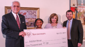 Jasmine Denson won a $1,000 donation to the charity of her choosing, Adullam House in Wetumpka.