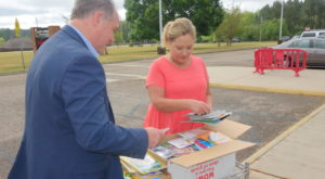 Dr. Kirk Davis and Kelly Springs Elementary Principal Wanda Dismukes sort through boxes of donated books.