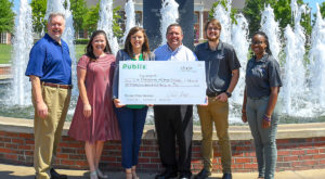 Publix of Troy presented a check on Tuesday to support the Troy University Office of Civic Engagement's ongoing efforts to fight food insecurity.