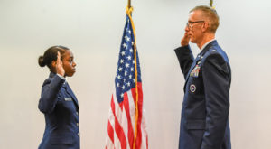 Christalyn Springs, left, was commissioned into the Air Force by Lt. Col. Stephen Cox at a ceremony in Troy in May.