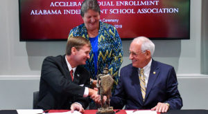 AISA Executive Director Michael McLendon and TROY Chancellor Dr. Jack Hawkins, Jr. shake hands following Tuesday's agreement signing.