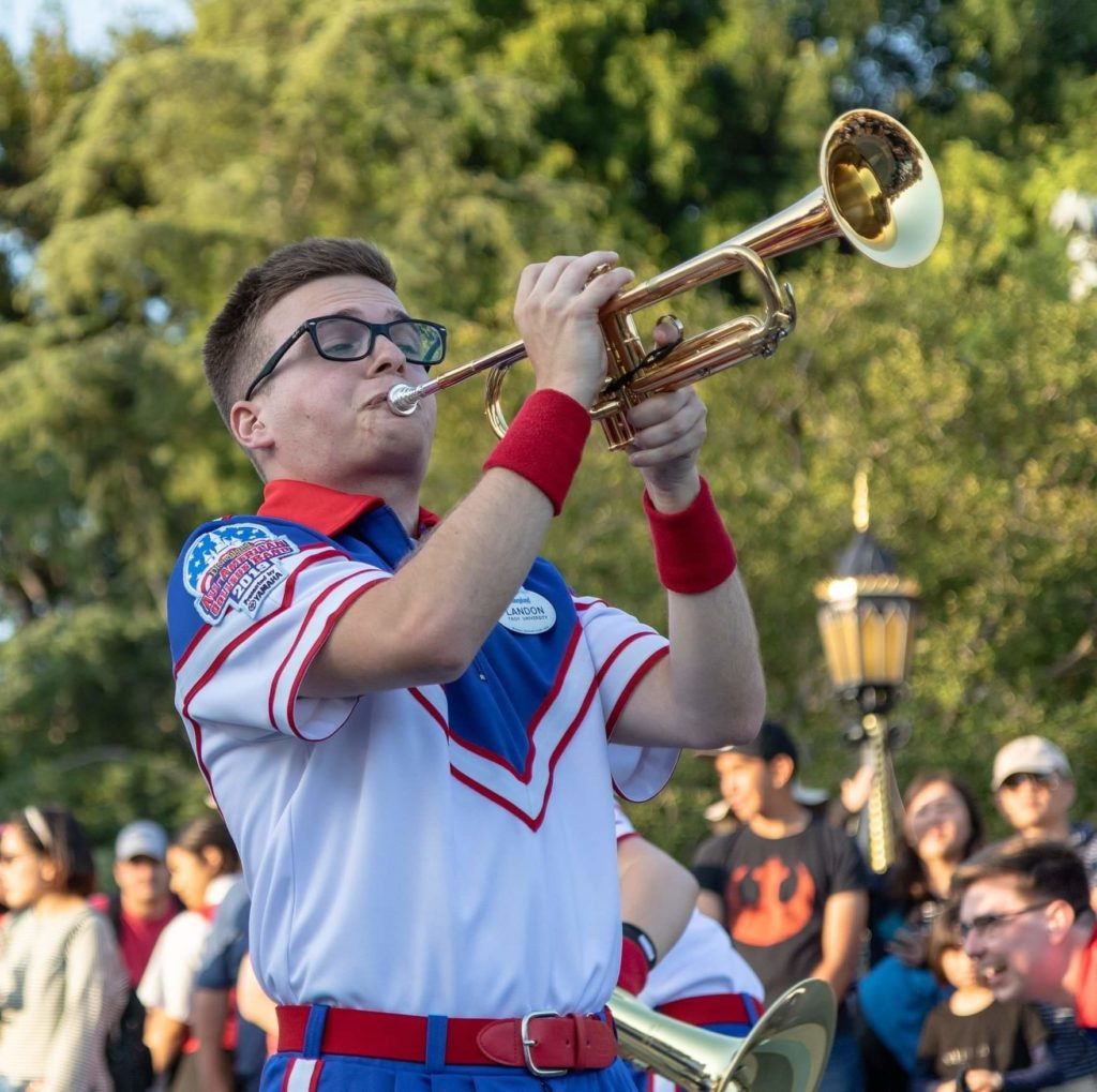 Landon Grigsby plays trumpet during one of his five daily performances at Disneyland.