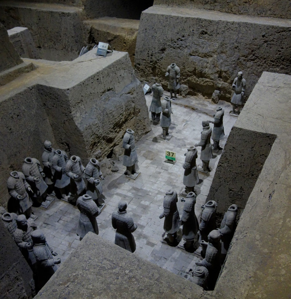 Numerous headless statues of the Terracotta Army stand in a vault in Xi'an, China.