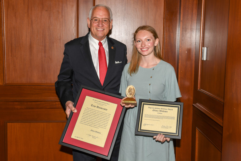 Olivia Walleser, a graduate of the Sorrell College of Business,  alongside Chancellor Dr. Jack Hawkins, Jr., with her 2019 Algernon Sydney Sullivan Award.