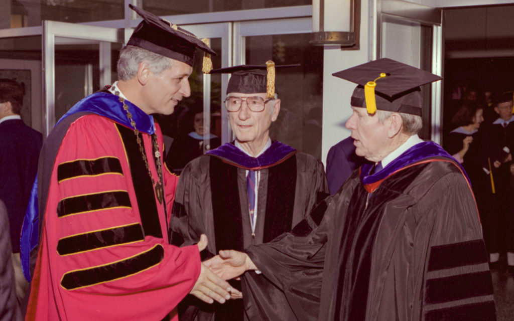 Dr. Jack Hawkins Jr., left, shakes hands with Dr. John M. Long, right, with Dr. Ralph Adams standing between them in this photo from Sept. 1, 1989.