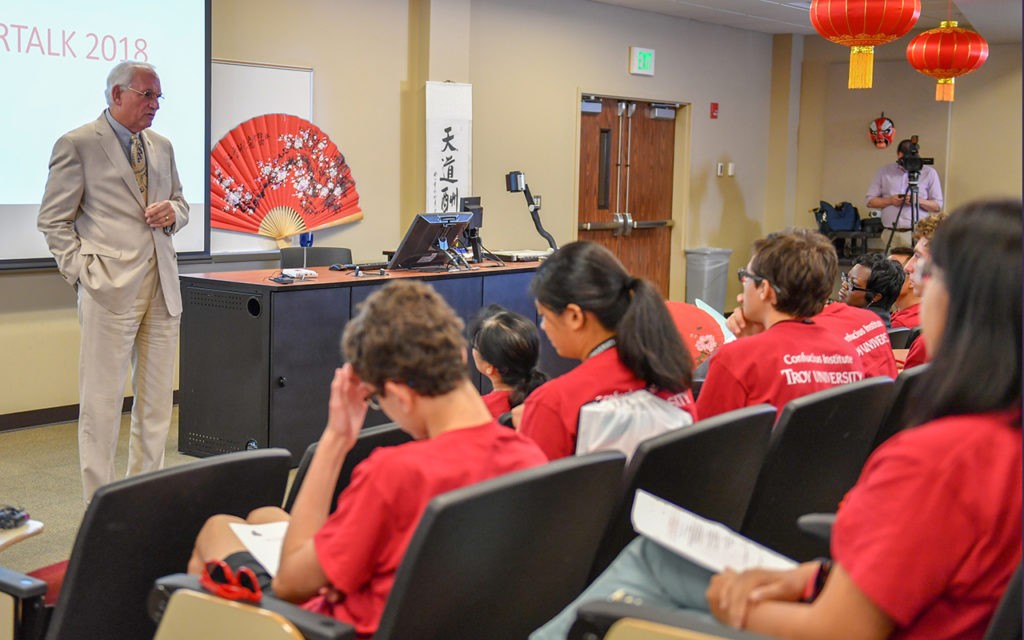 Dr. Jack Hawkins Jr., left, addresses students in the StarTalk Chinese language program.