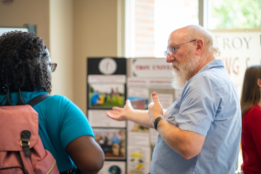 Troy University professor Dr. Bill Grantham, right, talks with a prospective student.