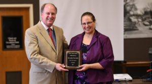Dr. Chris Shaffer, Dean of Library Services, presents Dr. Leora Waldner with Troy University Libraries' 2019 Book Token Award.