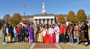 Troy University Chancellor Dr. Jack Hawkins, Jr. present a commendation from Gov. Kay Ivey with some of the University's international students.