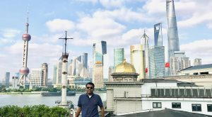 Alumnus Tushar Chaudhry, shown here in China, recently established a scholarship to support Indian students who wish to study at TROY.
