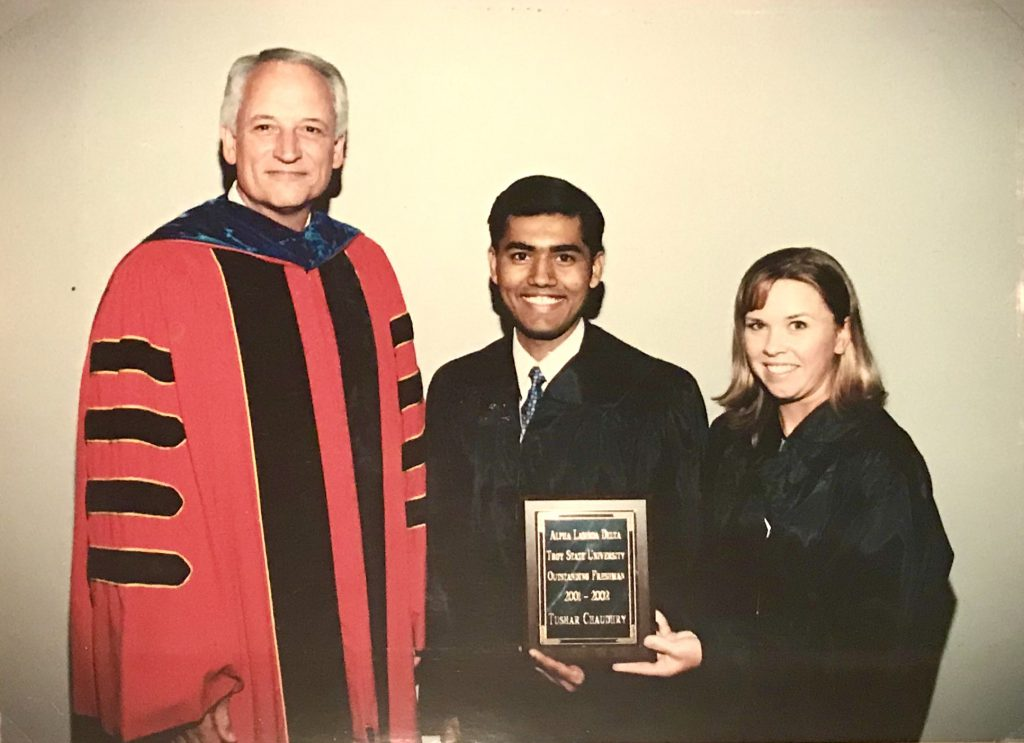 TROY alumnus Tushar Chaudhry being presenting the Outstanding Freshman award in 2002.