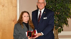 Chancellor Jack Hawkins, Jr. presents Barbara Jeffrey, secretary for the Department of Social Sciences, the Vergil Parks McKinley Award on Dec. 16.
