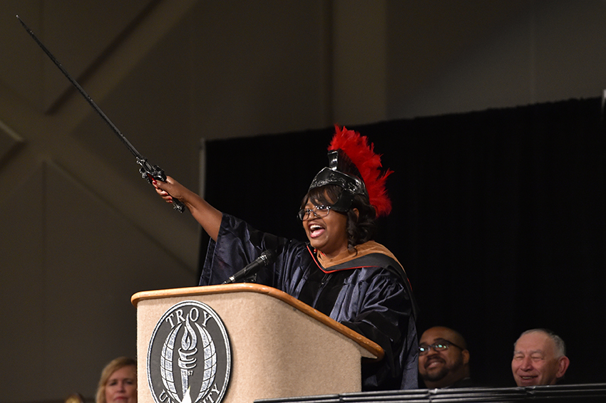 "Roz Durden, in her keynote address to graduates at the Phenix City Campus and Fort Benning, challenged graduates to ""be the sword."" (TROY photo/Clif Lusk)"