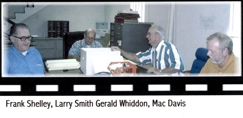 Workers archive photos in the 1990s.