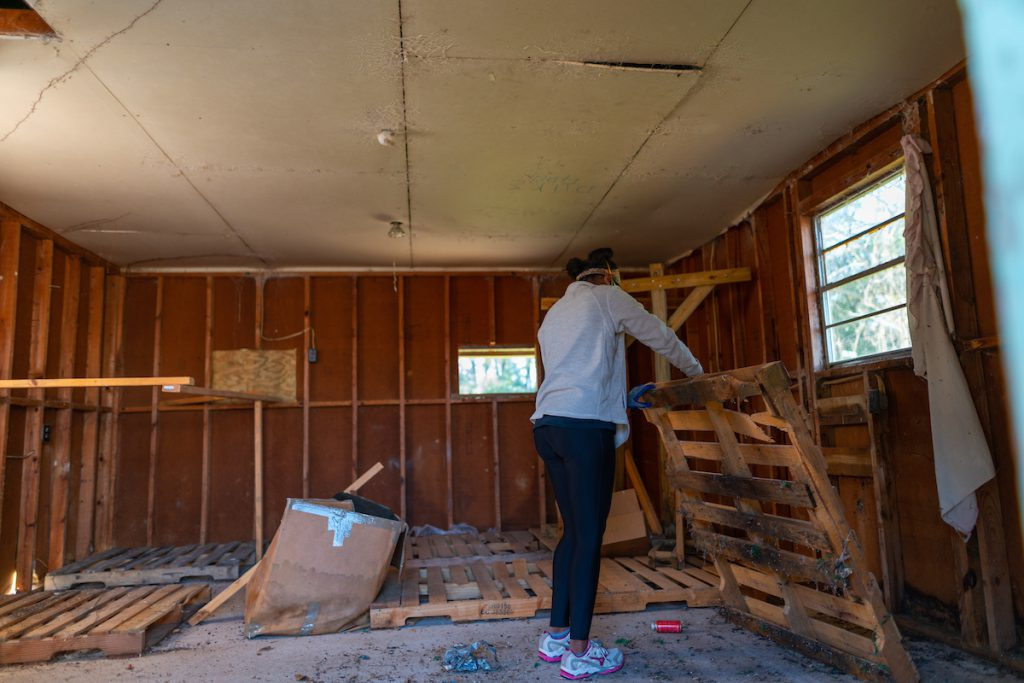 A Troy University student helps work on a house during MLK Days of Service.