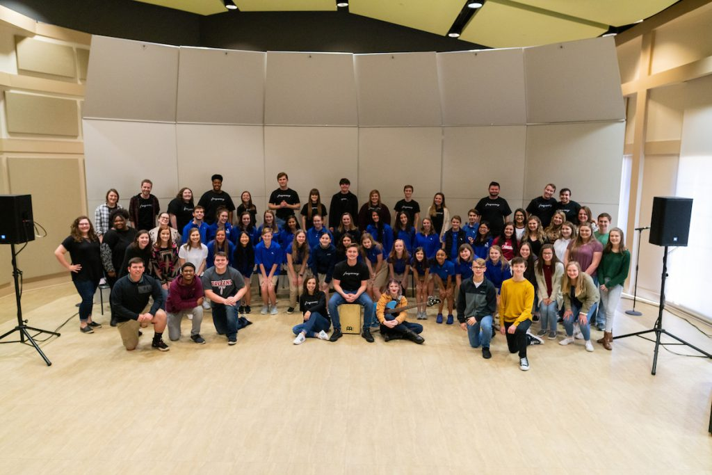 Vocal Jazz and More participants pose.