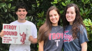Triplets Katherine, William and Kay-Lin Hornsby will officially become Trojans this fall.