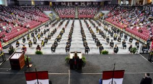 Troy University honored spring and summer graduates during three separate, socially-distanced commencement ceremonies on Friday at Trojan Arena.