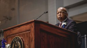 Rep. John Lewis, shown here speaking at the 2018 Leadership Conference, will lie in rest during a memorial service on Saturday at Trojan Arena.