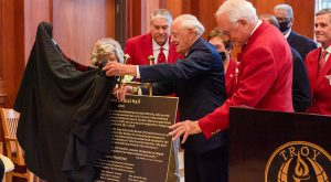 President Pro-tem Emeritus Gerald O. Dial, right, and his wife Faye unveil a plaque dedicating the Trojan Village 400 building as Gerald O. Dial Hall with Chancellor Dr. Jack Hawkins, Jr. and the University Board of Trustees. (TROY photo/Joey Meredith)