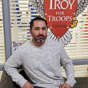 Jesse Roijas helps military connected TROY students in the Troy For Troops Center in Montgomery.