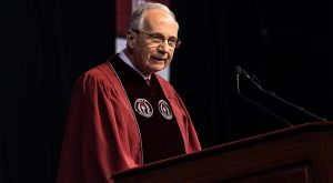 Tom Walker, founder and CEO of the American Village Citizenship Trust, addresses graduates on Friday during comencement ceremonies on the Troy Campus.
