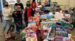 Phenix City Campus partners with Phenix City Housing Authority to provide brighter Christmas for families