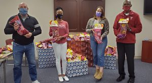 Employees from TROY's Montgomery Campus easily surpassed their goal for this year's Salvation Army Christmas Stocking Stuffers program.
