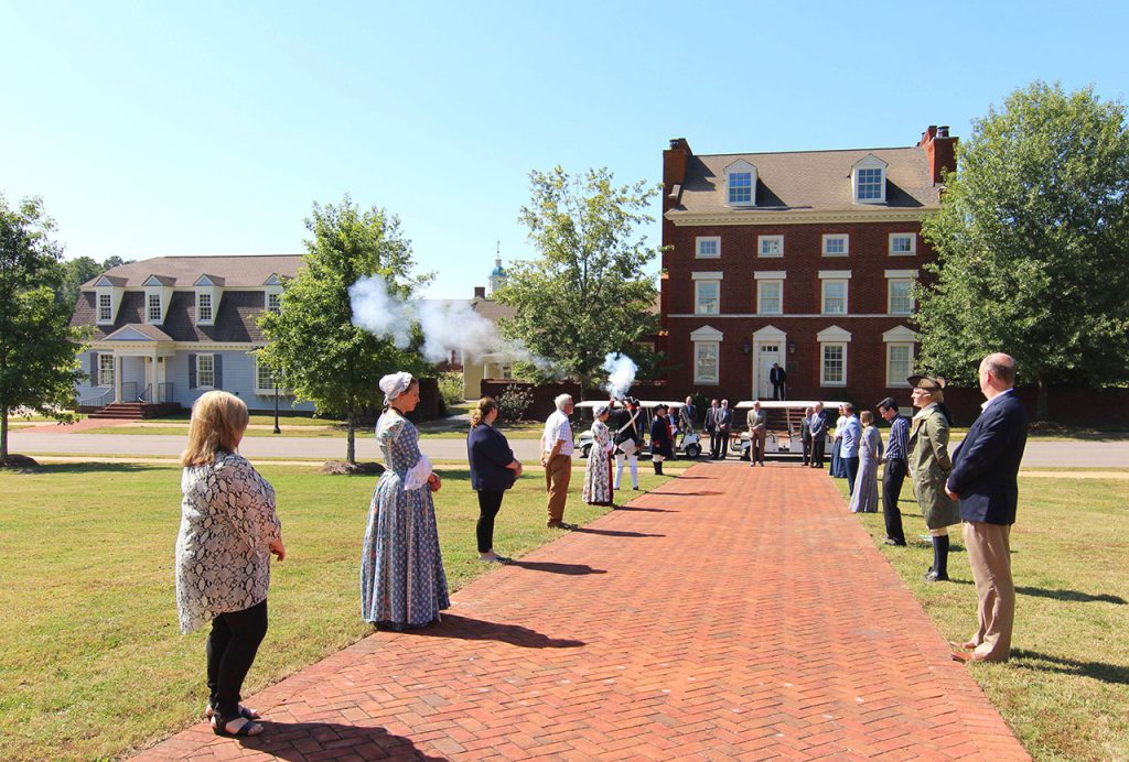 A musket salute lineup at American Village Citizens Trust.