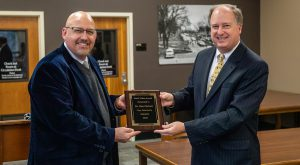 Puckett honored with Troy University's Book Token Award