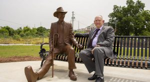 Former Vice Chancellor Dr. David White seated next to Albert Patterson at the dedication ceremony on June 26.